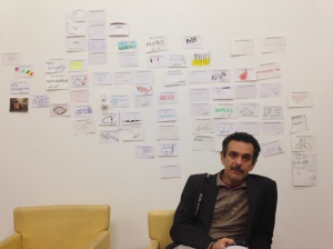 artist and curator Stefano W. Pasquini in front of the postcard wall